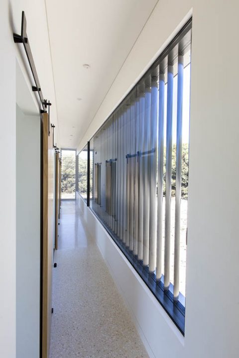Motorised vertical louvre panels