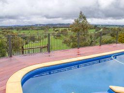 Wet timber decking next to pool