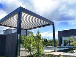 Free standing opening roof pergola by swimming pool