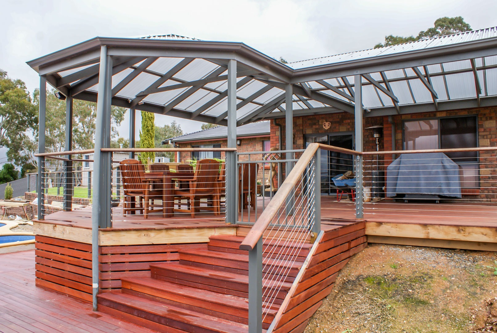 Raised timber verandah with metal balustrades