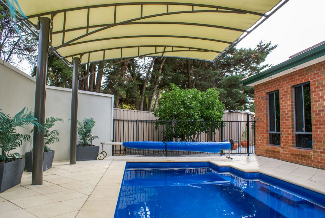 Vogue pergola protecting pool in South Australia