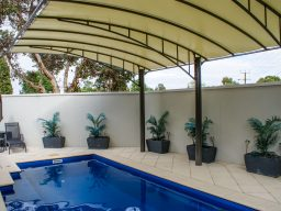 Wide span Vogue pergola shading pool from the sun
