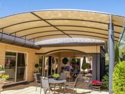 Vogue Pergola covering outdoor entertaining area